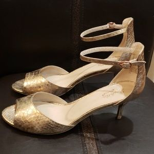 "Seychelle's Rose gold sandals with 2.5"" heel."